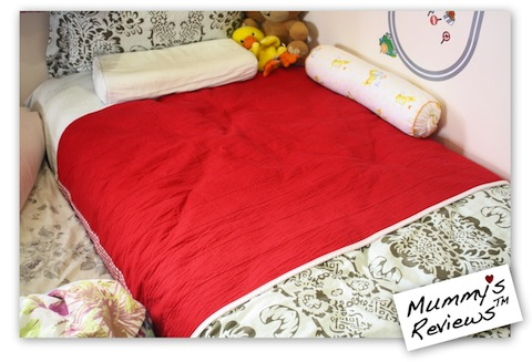 Mummy's Reviews - Brolly Sheets on bed